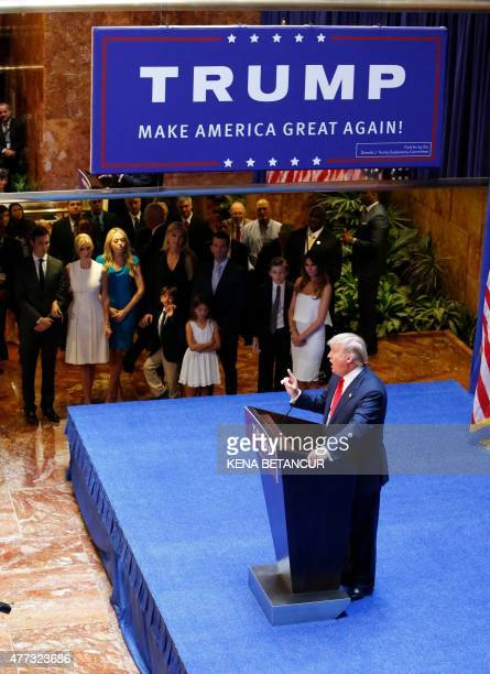 Real estate mogul Donald Trump announces his bid for the presidency in the 2016 presidential race as his family looks on during an event at the Trump...