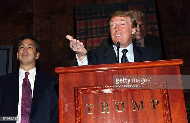 Real estate mogul Donald Trump gestures as he holds a media conference announcing the establishment of Trump University while President of Trump...
