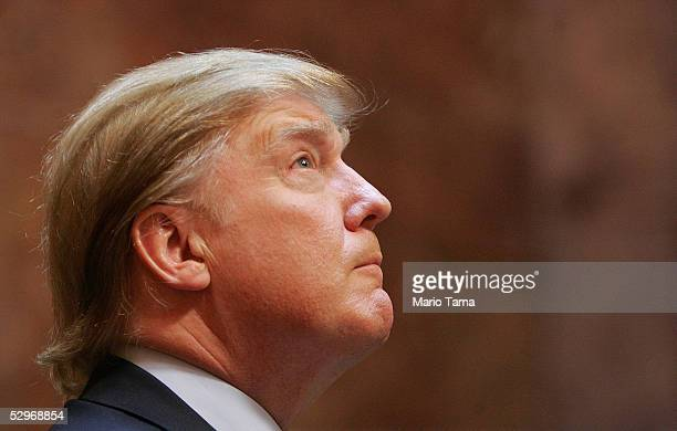 Real estate mogul Donald Trump looks on during a news conference announcing the establishment of Trump University May 23 2005 in New York City Trump...