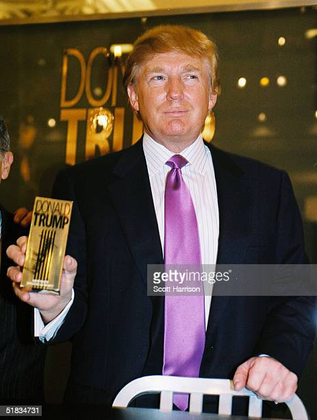 Real estate mogul Donald Trump makes a promotional appearance at Marshall Field's for his new cologne The Fragrance December 7 2004 in Chicago...