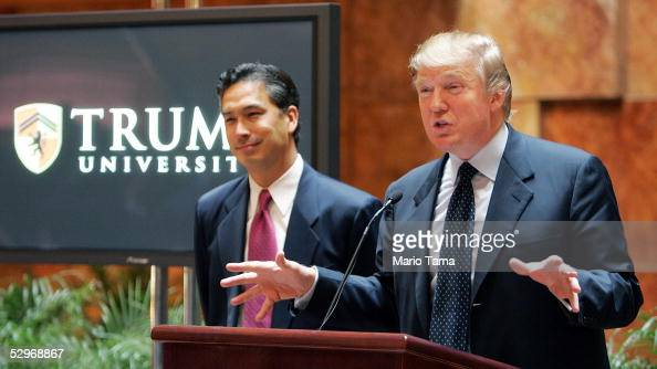 Real estate mogul Donald Trump speaks as university president Michael Sexton looks on during a news conference announcing the establishment of Trump...