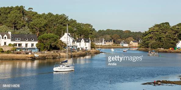 Real estate on the coast of La Trinite sur Mer houses on the seaside along the Crac'h river and sailing boat seen from St Philibert