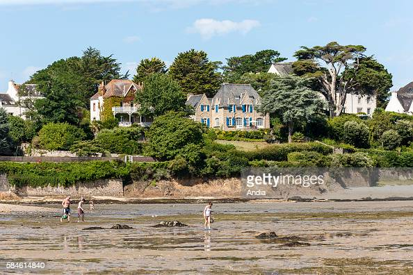 Real estate on the coast of La Trinite sur Mer houses on the seaside and fishing from the shore at low tide