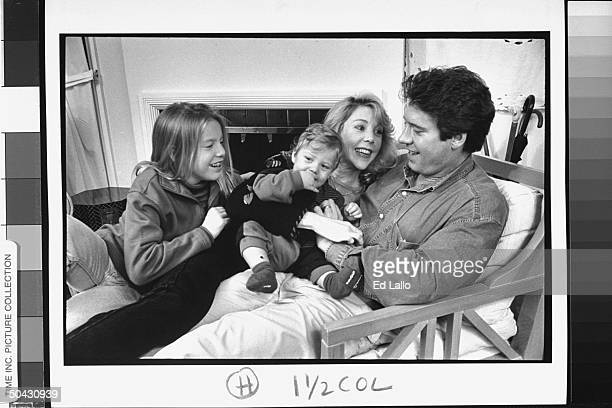Real estate salesman Kevin Loud former star of '73 PBS TV documentary series An American Family cuddling w his wife Judy kids Kristin KJ 11 mos while...