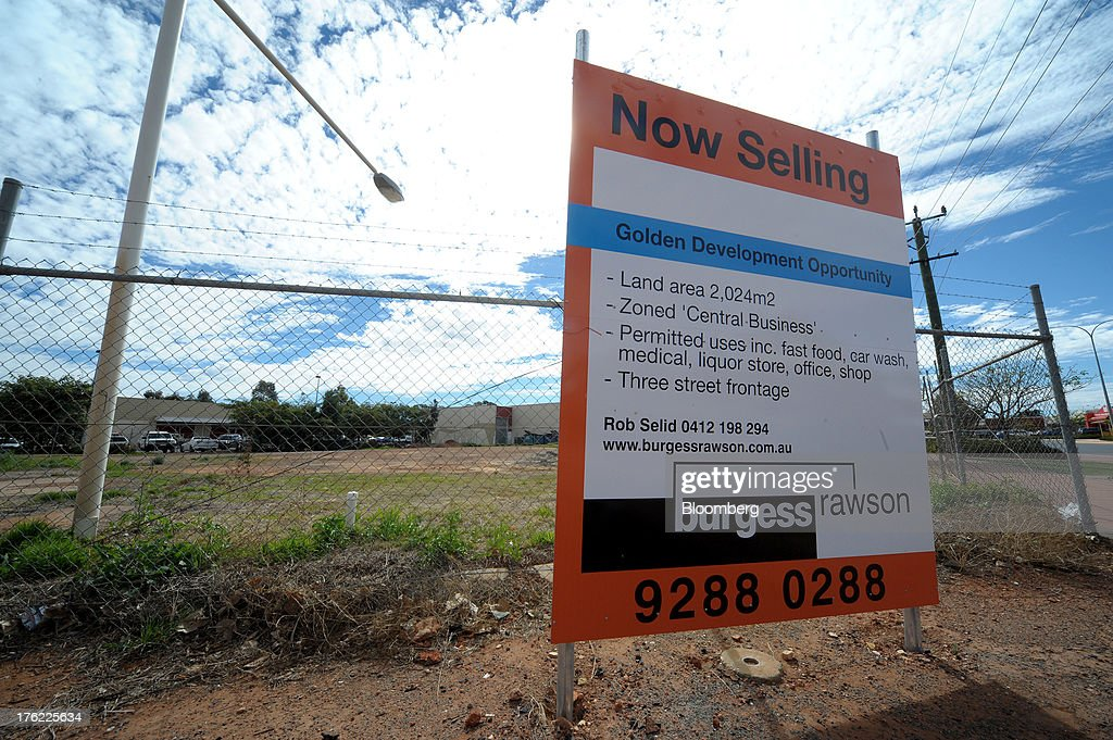 A real estate sign advertises a vacant block of land for sale on Hannan Street, the main street in the mining town of Kalgoorlie, Australia, on Thursday, Aug. 8, 2013. Western Australia, the nation's largest state by area with 2.6 million square kilometers (1 million square miles) of land, earned A$97 billion from minerals and energy sales in 2012, down from A$108 billion in 2011, according to government figures. Photographer: Carla Gottgens/Bloomberg via Getty Images