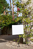 Real estate sign board outside house