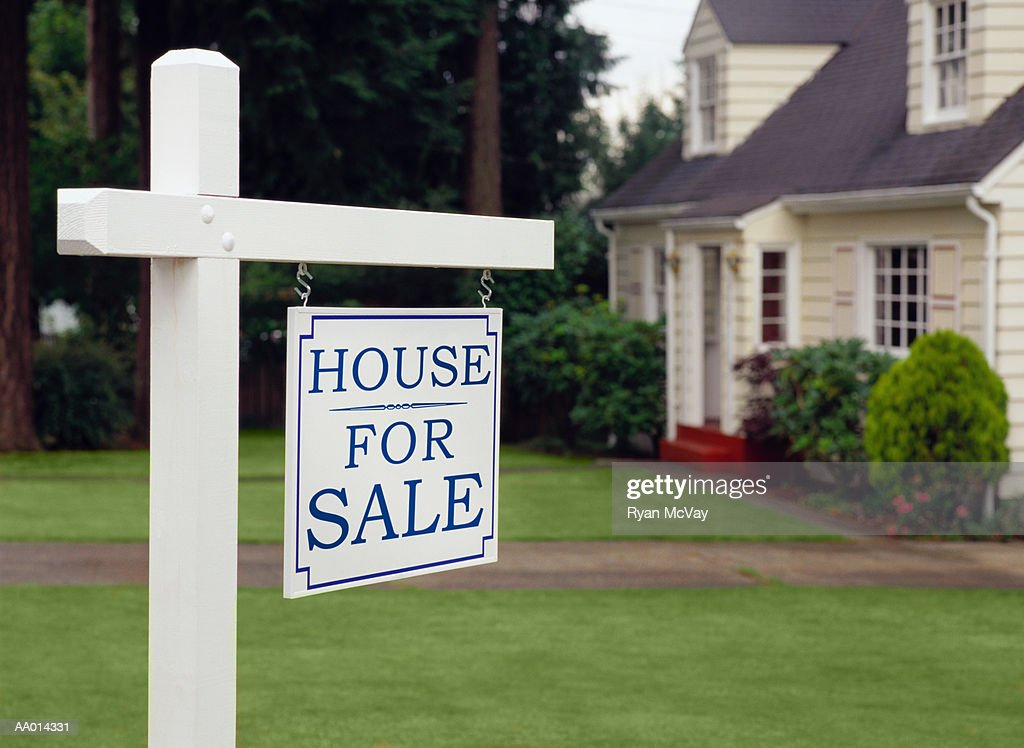 Real estate sign indicating house for sale : Stock Photo