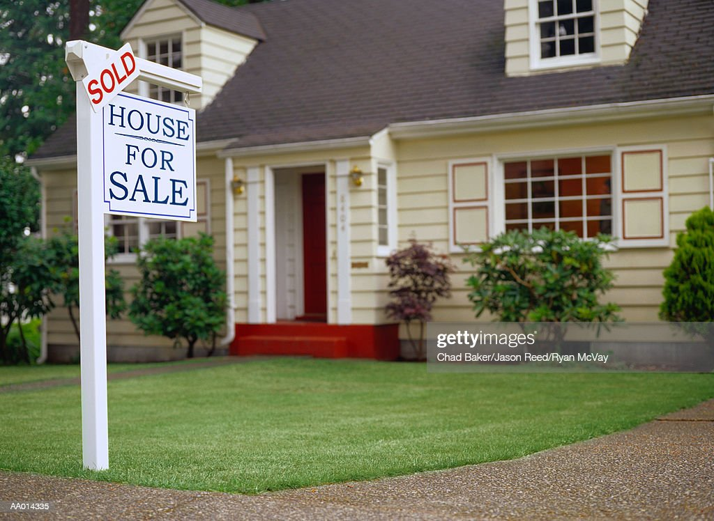 Real estate sign indicating sold house