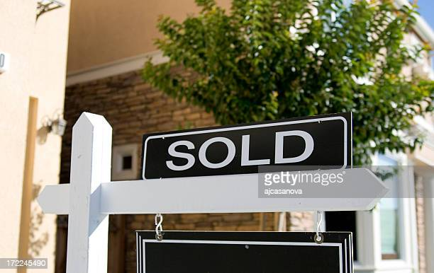 A real estate sign saying sold