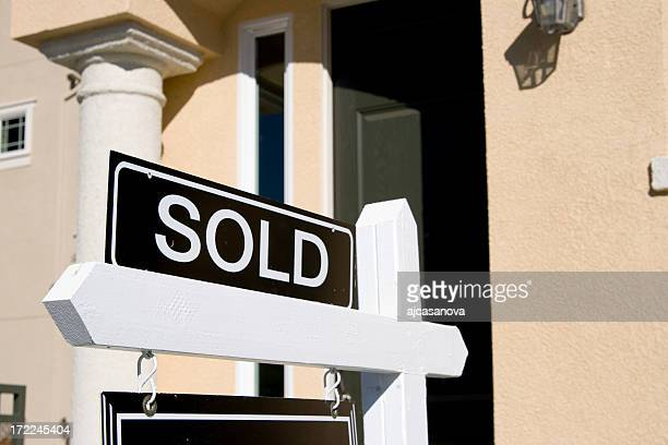 Real estate sign showing a sold house