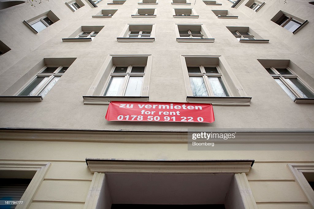 A real estate sign sits on a block of residential apartments and advertises a flat for rent 'Zu Vermieten' in the Mitte district of Berlin, Germany, on Monday, April 29, 2013. Rents and home prices in Germany's largest cities are rising at the fastest rate in twenty years, according to data compiled by Bulwien Gesa AG. Photographer: Krisztian Bocsi/Bloomberg via Getty Images