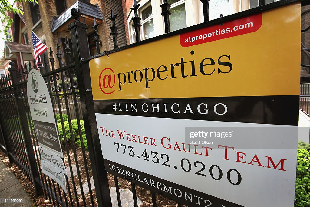 A real estate sign stands in front of a home on May 31, 2011 in Chicago, Illinois. According to the Standard & Poor's Case-Shiller Home Price Index home prices fell in March in 18 of the 20 metropolitan areas monitored by the index, reaching their lowest levels since the housing bubble burst in 2006. In Chicago, were nearly 30 percent of homes offered for sale are bank owned, prices have fallen 7.6 percent from a year ago.