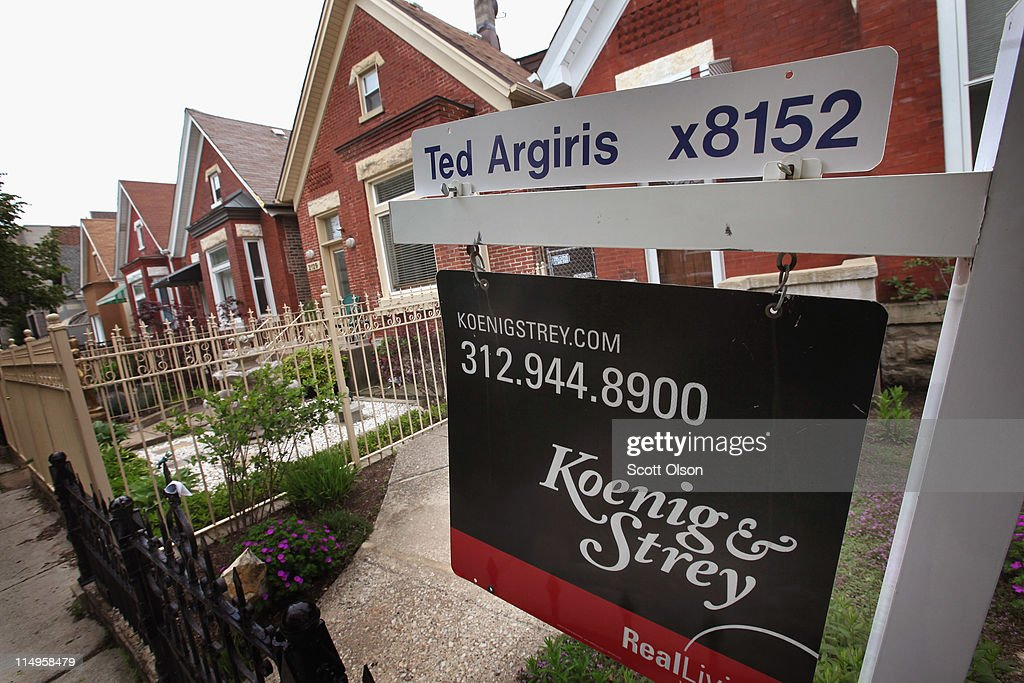 A real estate sign stands in front of a house on May 31, 2011 in Chicago, Illinois. According to the Standard & Poor's Case-Shiller Home Price Index home prices fell in March in 18 of the 20 metropolitan areas monitored by the index, reaching their lowest levels since the housing bubble burst in 2006. In Chicago, were nearly 30 percent of homes offered for sale are bank owned, prices have fallen 7.6 percent from a year ago.