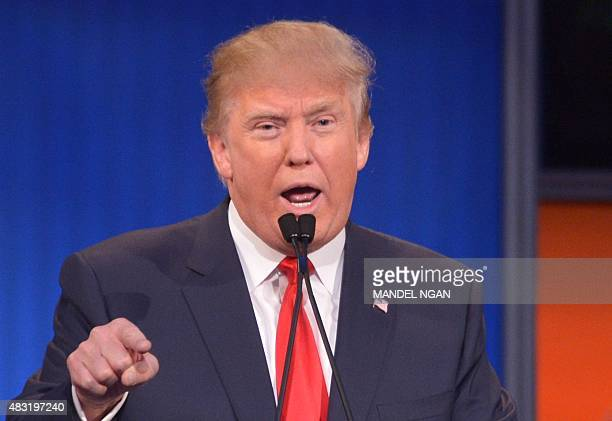 Real estate tycoon Donald Trump participates in the Republican presidential primary debate on August 6 2015 at the Quicken Loans Arena in Cleveland...