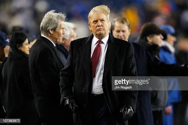 Real estate tycoon Donald Trump stands on the sidelines as of the New England Patriots and the New York Jets warm up prior to their game at Gillette...