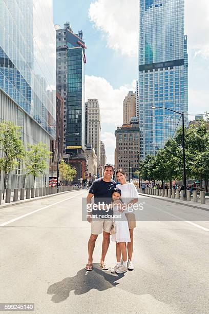 Real family of three posing in an empty New-York street.
