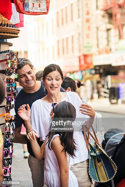 Real family shopping in the streets of New-York in summer.