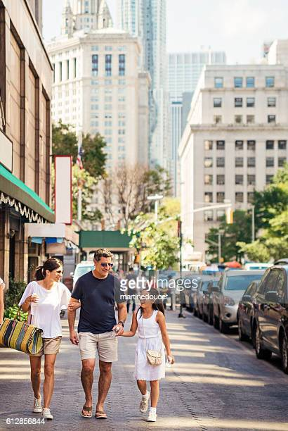 Real family walking in the streets of New-York in summer.