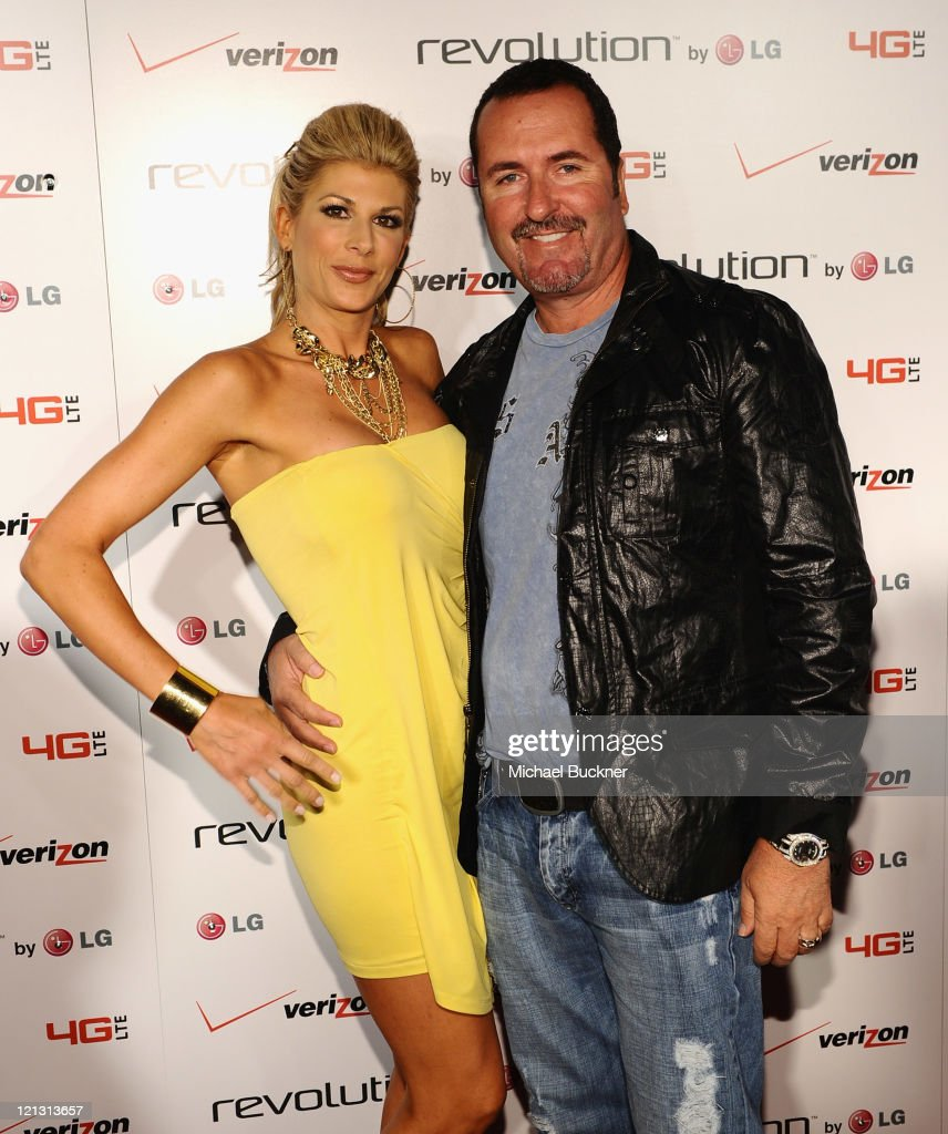 Real Housewife of Orange County <a gi-track='captionPersonalityLinkClicked' href=/galleries/search?phrase=Alexis+Bellino&family=editorial&specificpeople=6544408 ng-click='$event.stopPropagation()'>Alexis Bellino</a> (L) and husband Jim Bellino attend the LG Revolution party hosted by Verizon at The Sayers Club on August 17, 2011 in Hollywood, California.