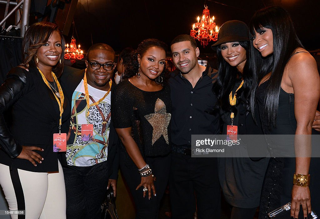 'Real Housewives of Atlanta' cast members <a gi-track='captionPersonalityLinkClicked' href=/galleries/search?phrase=Kandi+Burruss&family=editorial&specificpeople=4401257 ng-click='$event.stopPropagation()'>Kandi Burruss</a>, Derek J, Phaedra, Apollo Nida, <a gi-track='captionPersonalityLinkClicked' href=/galleries/search?phrase=Cynthia+Bailey&family=editorial&specificpeople=3055318 ng-click='$event.stopPropagation()'>Cynthia Bailey</a> and Marlo Hampton attend Cirque du Soleil TOTEM Premiere at Atlantic Station on October 26, 2012 in Atlanta, Georgia.