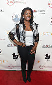 Real Housewives of Atlanta star Kandi Burruss attends the Get On Up premiere at Regal CinemasAtlantic Station on July 25 2014 in Atlanta Georgia