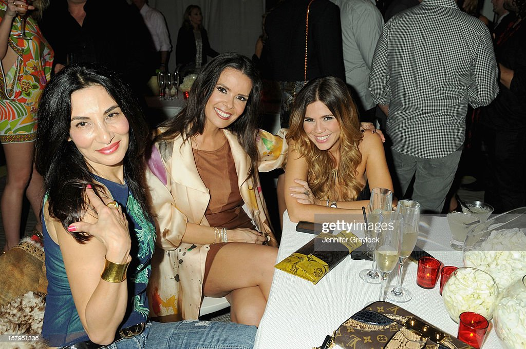 Real Housewives of Miami cast member Karent Sierra (center) attends the Haute Living Hublot And Ferrari Honor Domingo Zapata For Art Basel 2012 on December 7, 2012 in Miami, United States.