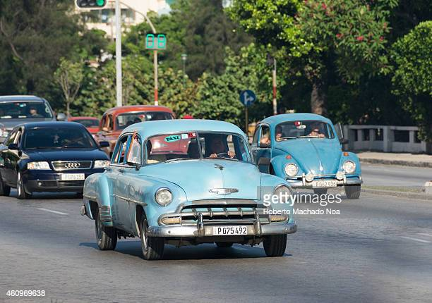 Real life traffic view or scene in Havana during 2014 and including old and modern cars running in the avenue