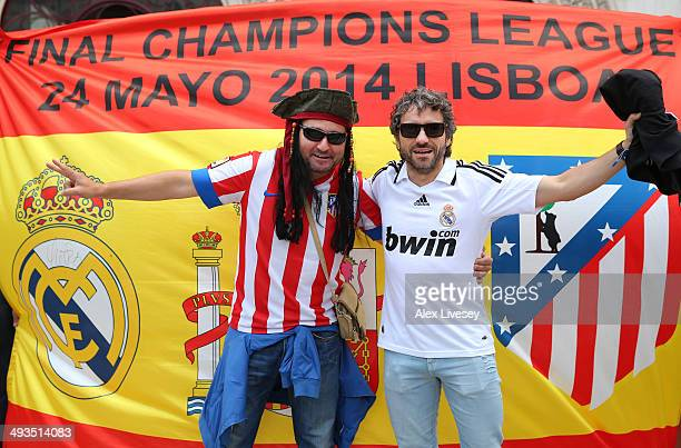 Real Madrid and Atletico de Madrid supporters gather in the city centre ahead of the UEFA Champions League Final between Real Madrid and Atletico de...