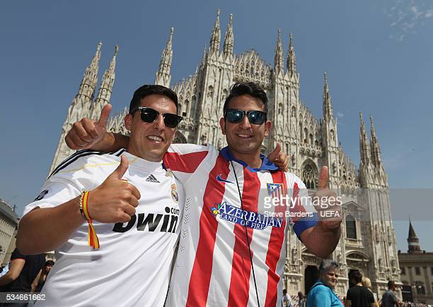 Real Madrid and Atletico Madrid supporter pose for a picture during the Fans Festival outside the Duomo in the centre of Milan prior to the UEFA...