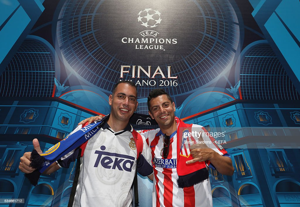 A Real Madrid and Atletico Madrid supporter pose for a picture during the Fans Festival in the centre of Milan prior to the UEFA Champions League Final between Real Madrid and Atletico Madrid on May 27, 2016 in Milan, Italy.