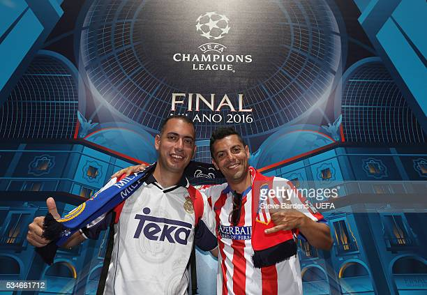 Real Madrid and Atletico Madrid supporter pose for a picture during the Fans Festival in the centre of Milan prior to the UEFA Champions League Final...