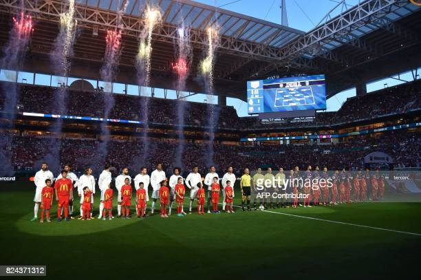 Real Madrid and Barcelona teams pose during their International Champions Cup football match at Hard Rock Stadium on July 29 2017 in Miami Florida...