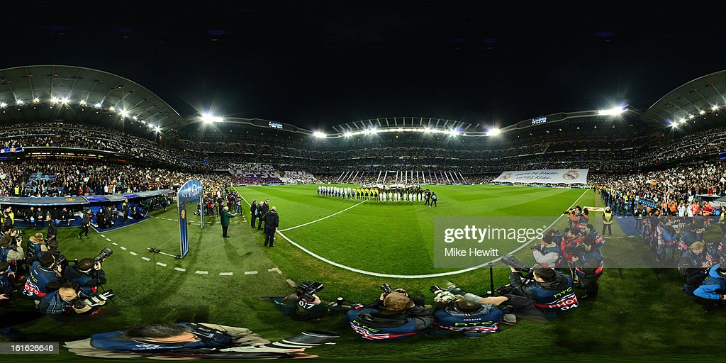 Real Madrid and Manchester United line up prior to the UEFA Champions League Round of 16 first leg match between Real Madrid and Manchester United at Estadio Santiago Bernabeu on February 13, 2013 in Madrid, Spain.