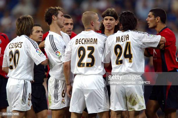 Real Madrid and Osasuna players argue after a nasty challenge by David Beckham