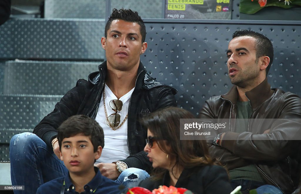 Real Madrid and Portugal footballer Cristiano Ronaldo watches Rafael Nadal of Spain in action against Joao Sousa of Portugal in their quarter final round match during day seven of the Mutua Madrid Open tennis tournament at the Caja Magica on May 06, 2016 in Madrid,Spain.