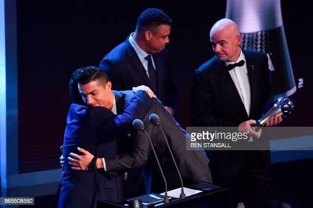 Real Madrid and Portugal forward Cristiano Ronaldo embraces Argentina's former player Diego Maradona as he wins The Best FIFA Men's Player of 2017...