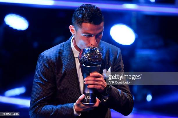 Real Madrid and Portugal forward Cristiano Ronaldo kisses the trophy after winning The Best FIFA Men's Player of 2017 Award during The Best FIFA...