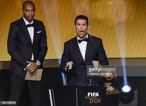 Real Madrid and Portugal forward Cristiano Ronaldo reacts next to French former star player Thierry Henry after receiving the 2014 FIFA Ballon d'Or...
