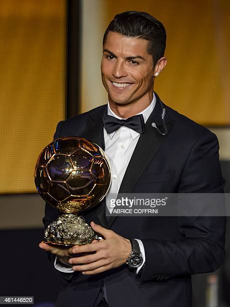 Real Madrid and Portugal forward Cristiano Ronaldo smiles after receiving the 2014 FIFA Ballon d'Or award for player of the year during the FIFA...