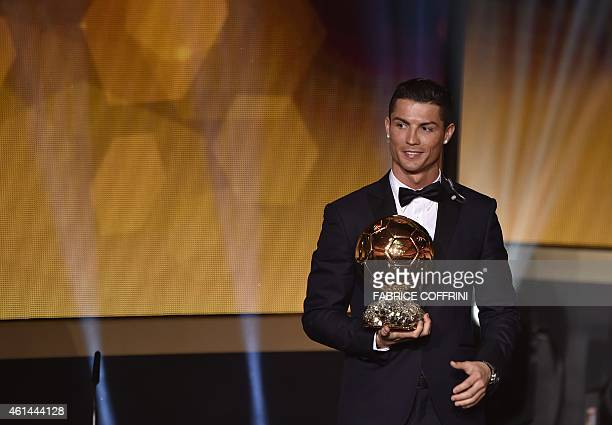 Real Madrid and Portugal forward Cristiano Ronaldo stands on stage after receiving the 2014 FIFA Ballon d'Or award for player of the year during the...