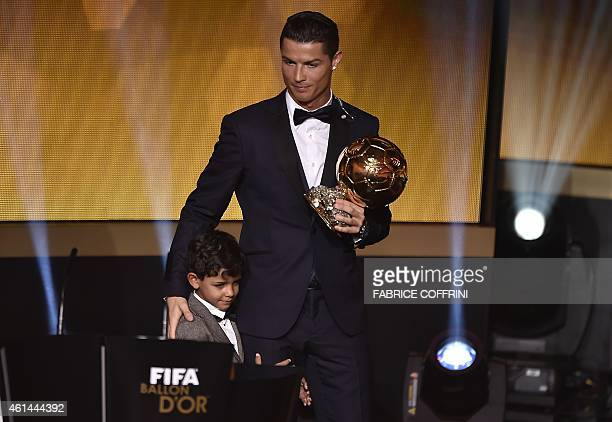 Real Madrid and Portugal forward Cristiano Ronaldo stands on stage with his son Cristiano Jr after receiving the 2014 FIFA Ballon d'Or award ceremony...