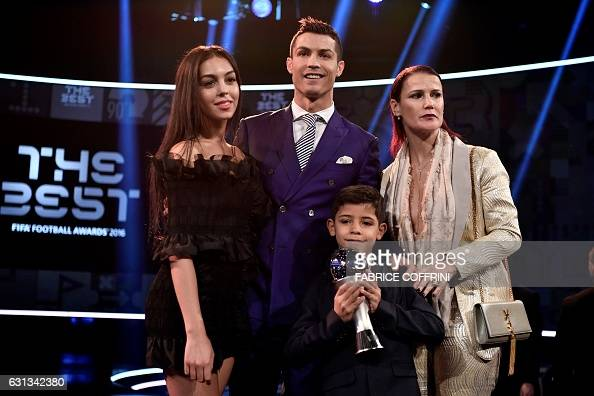 Real Madrid and Portugal's forward and winner of The Best FIFA Mens Player of 2016 Award Cristiano Ronaldo poses with partner Georgina Rodriguez...