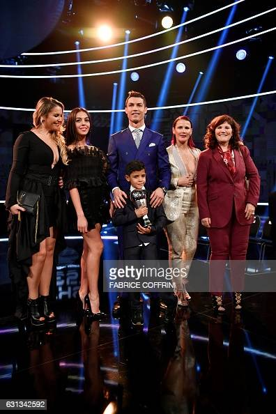 Real Madrid and Portugal's forward and winner of The Best FIFA Mens Player of 2016 Award Cristiano Ronaldo poses with partner Georgina Rodriguez his...
