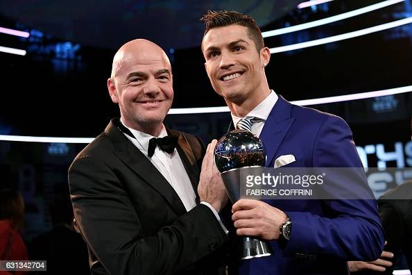 Real Madrid and Portugal's forward and winner of The Best FIFA Mens Player of 2016 Award Cristiano Ronaldo poses with FIFA president Gianni Infantino...