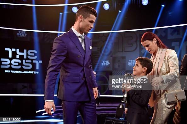 Real Madrid and Portugal's forward and winner of The Best FIFA Mens Player of 2016 Award Cristiano Ronaldo stands on stage with his son Cristiano...