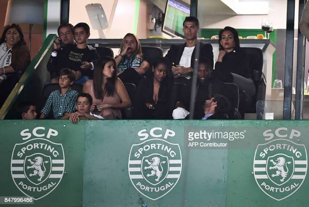 Real Madrid and Portugal's forward Cristiano Ronaldo and his girlfriend Georgina Rodriguez attend the Portuguese league football match Sporting CP vs...