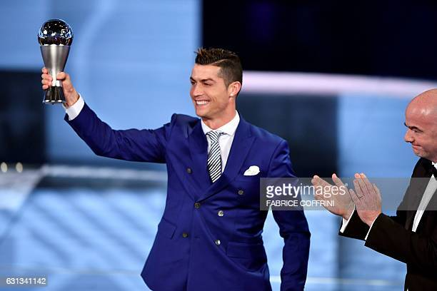 Real Madrid and Portugal's forward Cristiano Ronaldo holds his trophy after winning the The Best FIFA Mens Player of 2016 Award next to FIFA...