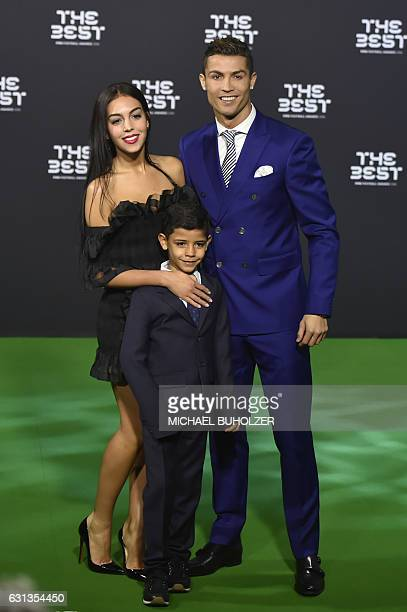 Real Madrid and Portugal's forward Cristiano Ronaldo poses with partner Georgina Rodriguez and his son Cristiano Ronaldo Jr as they arrive for The...
