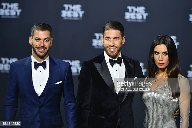 Real Madrid and Spain's defender Sergio Ramos his wife Spanish TV presenter Pilar Rubio and his brother Rene Ramos pose as they arrive for The Best...