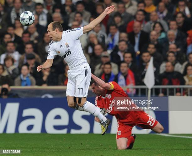 Real Madrid Arjen Robben and Liverpool's Jamie Carragher battle for the ball